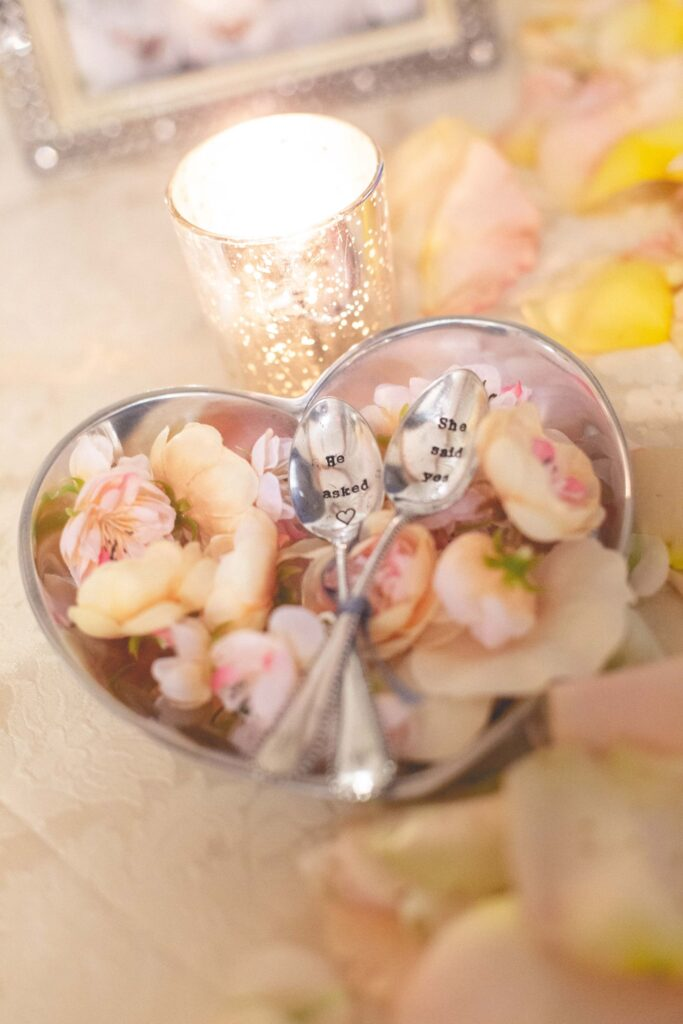 Wedding details of spoons with text 'he asked' and 'she said yes'